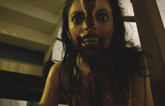 Photo from V/H/S - Hired to steal a rare VHS tape from a secluded house, a group of petty crooks breaks in and discovers a corpse surrounded by TVs and stacks of tapes. Now they must watch each horrific and bizarre video as they search for the correct one