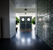 Photo of the front door - Moonshine Studios on the Beltline in Atlanta old 4th ward, aka Beltline Studios, has in addition to its Sound Stage, a Producer's Room, Green Room, Private Entrance, Gated and Secure Parking, Private Bathrooms, Showers, and Cantina for Catering Space. We also offer full service Post Production services and over 10,000 square feet of production offices