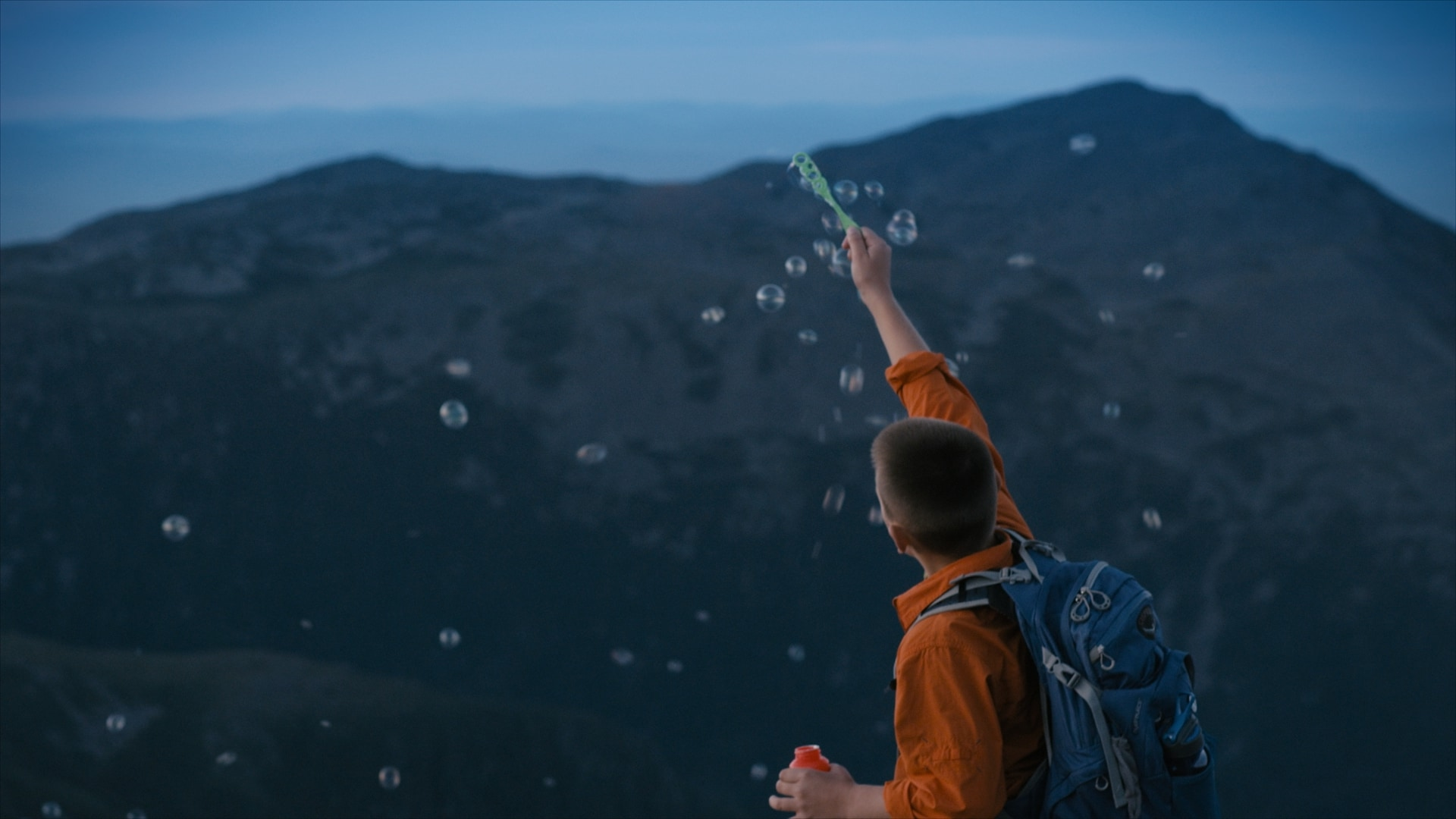 Still of kid blowing bubbles from Visit New Hampshire commercial - With over 20 years of experience, Moonshine Post Production's John Petersen, our senior colorist, runs a tight ship with his colorists and he himself has colored and supervised the majority of feature films shot in the Atlanta area in the the last 5 years alone.