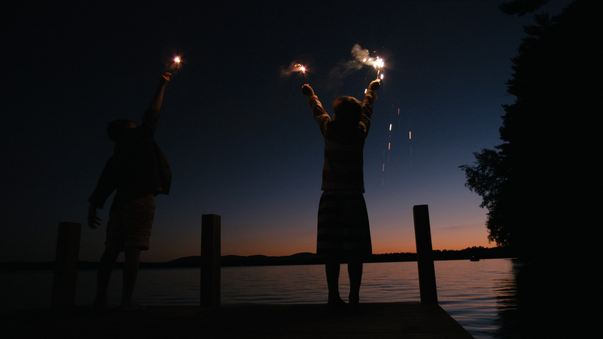 Still of kids with sparklers from Visit New Hampshire commercial - With over 20 years of experience, Moonshine Post Production's John Petersen, our senior colorist, runs a tight ship with his colorists and he himself has colored and supervised the majority of feature films shot in the Atlanta area in the the last 5 years alone.
