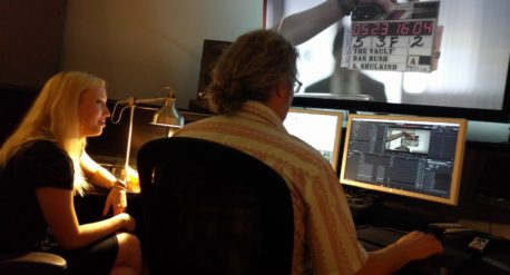 Photo of John Petersen and Caroline Oelkers checking sound sync on The Vault's feature Dailies pass at Moonshine Post Production in Atlanta Georgia