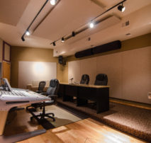 Photo of inside our main 5.1 Audio Studio A with VO Booth and ready for feature and television sound sweeting, mixing, ADR, recording, and master. This and Audio Studio B are essential to the finishing process in post production.